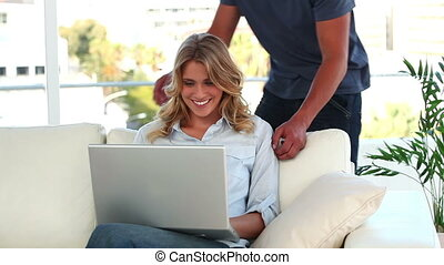 Cheerful couple looking at a laptop