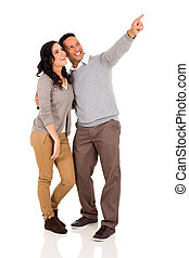 couple pointing at empty copy space