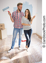 Cheerful couple renovating their new apartment