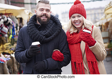 Cheerful couple with a cup of coffee