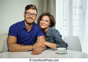 Cheerful couple with tablet pc at home