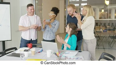 Cheerful coworkers celebrating - Group of multiethnic people...