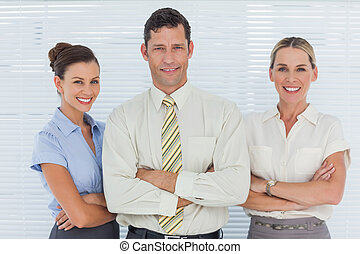 Cheerful coworkers posing together