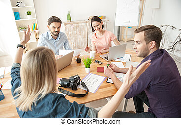 Cheerful creative team is working with joy