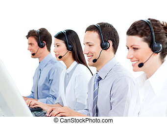 Cheerful customer service agents working in a call center...