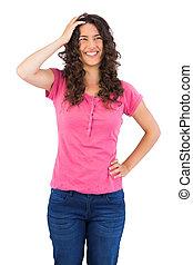 Cheerful cute brunette posing