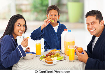 cute indian family enjoying their breakfast
