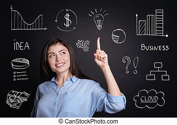 Cheerful delighted businesswoman having an idea.