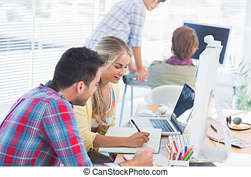 Cheerful designers working on a document