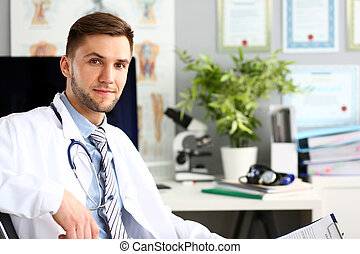 Cheerful doctor in clinic office