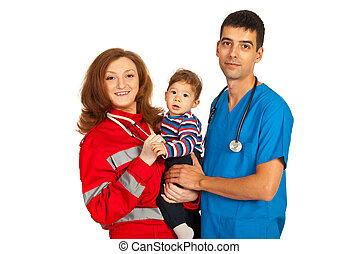 Cheerful doctors holding baby