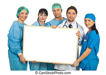 Cheerful doctors with blank banner