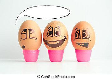 Cheerful eggs three friends, brown eggs
