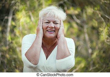 Cheerful elderly woman .