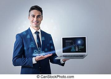 Cheerful elegant man is showing diagram