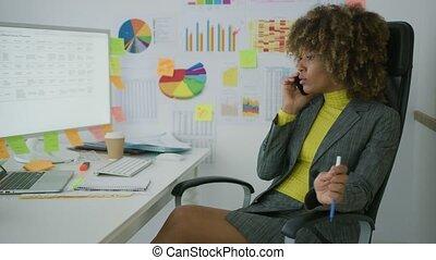 Cheerful elegant worker talking on phone - Elegant stylish...