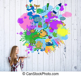 Cheerful eurpean girl with open book on light plank background with colorful splashes. Creativity concept