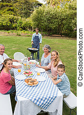 Cheerful extended family having a barbecue