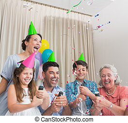 Cheerful extended family playing wi