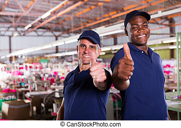 factory supervisors giving thumbs up