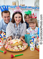 Cheerful family celebrating mother\'s birthday