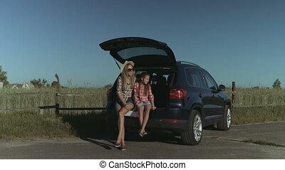 Cheerful family enjoying nature during road trip - Charming...
