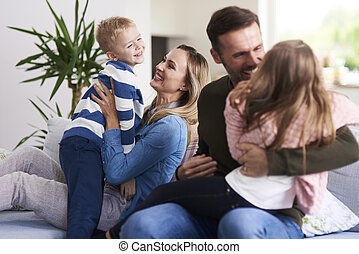 Cheerful family enjoying together at home