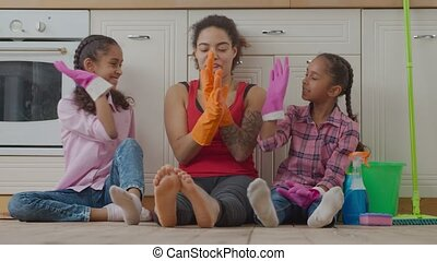 Cheerful family giving high five after cleanup - Cheerful ...