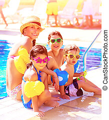 Big cheerful family having fun on beach resort, active lifestyle, spending time together near poolside, summer vacation and traveling concept