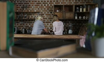 Cheerful family preparing cookies in the kitchen - Multi...