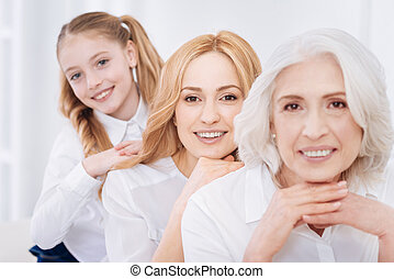 Cheerful family resting together at home