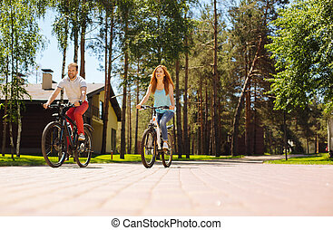 Cheerful family riding bikes together