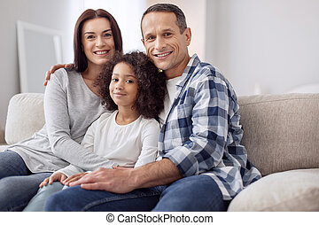 Cheerful family sitting on the sofa