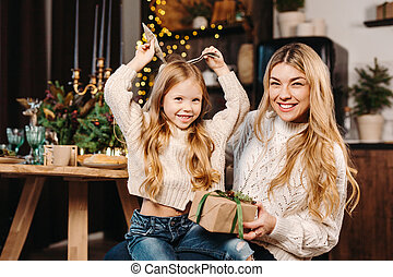 cheerful family spending Christmas time together at home
