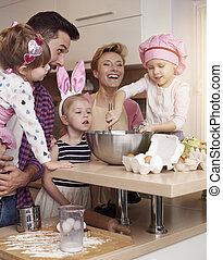 Cheerful family spending time in the kitchen