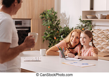 Cheerful family spending weekend at home