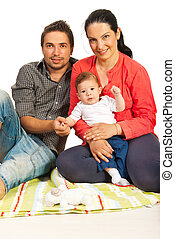 Cheerful family with baby