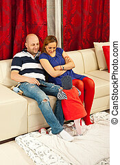 Cheerful family with baby in living room