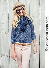 Cheerful fashionable blonde posing