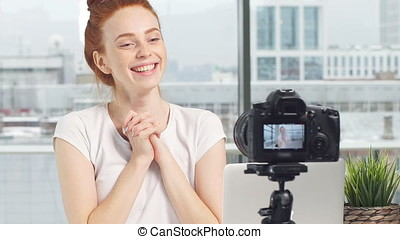 Cheerful female blogger recording video. - Cheerful female...