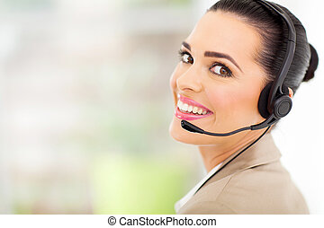 cheerful female call center telemarketer with headset