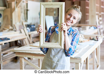 Cheerful Female Carpenter Posing in Joinery - Portrait of...