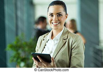 female entrepreneur using tablet computer