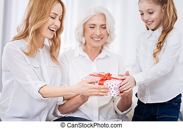 Cheerful female family members expressing joy at home