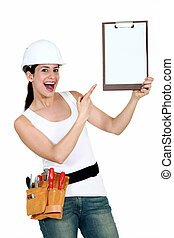 Cheerful female laborer showing notepad