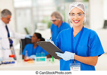 female medical researcher writing report - cheerful female...