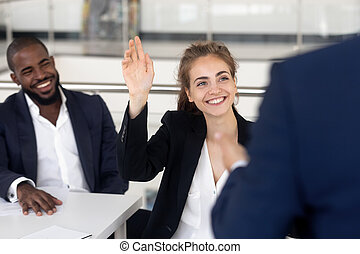 Cheerful female student asking questions business coach during seminar