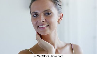 Cheerful female touching neck