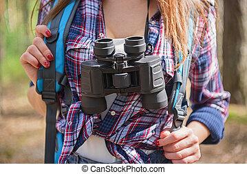 Cheerful female tourist with equipment