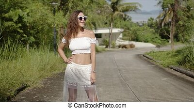 Cheerful female walking on path in tropical country - Happy ...